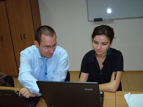Cristian Ducu (BCAE Chief-Coordinator) and Alexandra Bulboaca (Conference Assistant) making the last adjustments